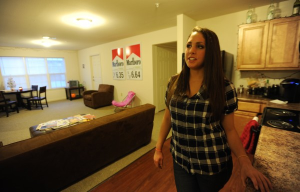 Lindsey Lavoie stands in her apartment at The Grove apartment complex in Orono on Tuesday, Jan. 29, 2013. Lavoie shares the apartment with two others and has had mold issues when she first moved in this past fall.
