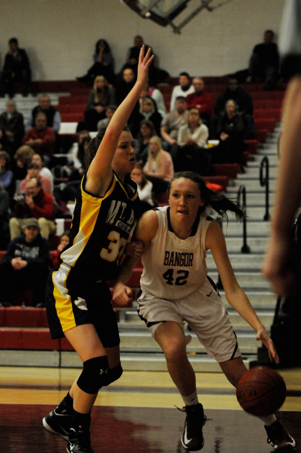 Bangor's Mary Butler drives to the basket while being closely guarded by Mt. Blue's Miranda Nicely on Tuesday, Jan. 29, 2013 in Bangor.