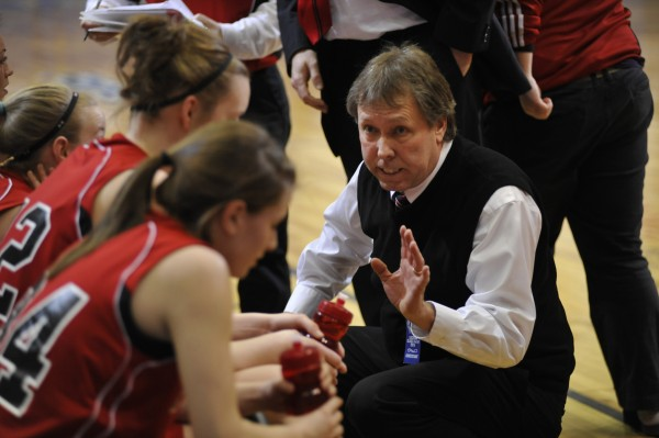 Fort Fairfield coach Larry Gardner huddles with his team during a timeout during a tourney game in February 2011. Gardner reached 300 career coaching wins Saturday night.