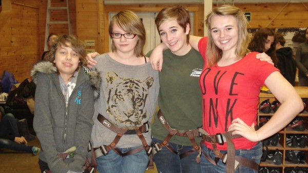 (From Left to Right): Thomaston Grammar School 7th graders Bailey Noble-Roy and Molli Moholland with Trekkers' junior leaders Raegan Goulet and Sienna Barstow at Camp Kieve's climbing wall during Trekkers Week in January.