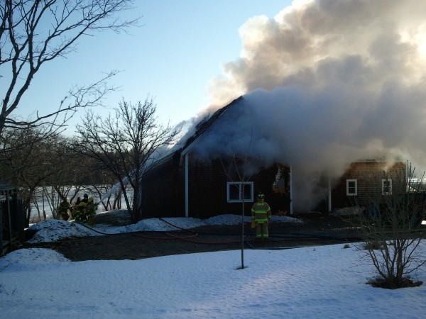 Firefighters douse a burning house with water in Trenton on Tuesday, Jan. 29, 2013.