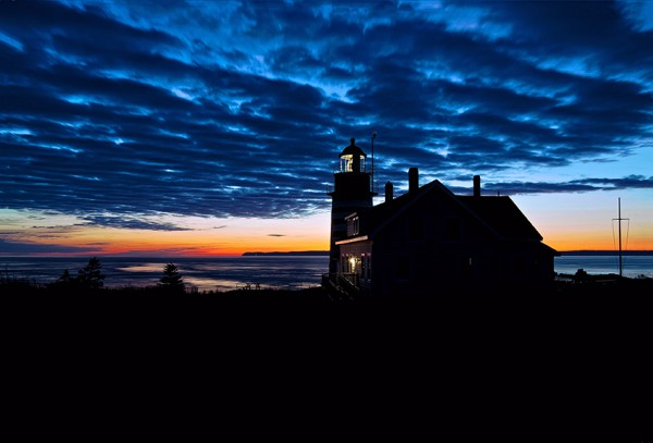 West Quoddy Head Lighthouse silhouetted in pre dawn light