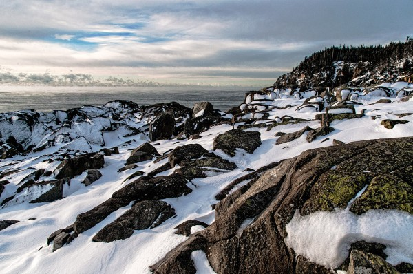 Early morning light on snow covered Coastal Trail landscape