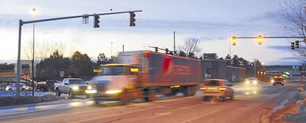 "A Pepsi-Cola ""big rig"" rolls inbound on Main Street at its intersection with Interstate-395 about 6:40 a.m. Vehicle head- and taillights indicates that the commuting tempo is picking up as the work day begins in mid-January."