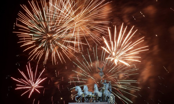 Fireworks explode during New Year's celebrations over the Brandenburger Tor gate in Berlin January 1, 2013.