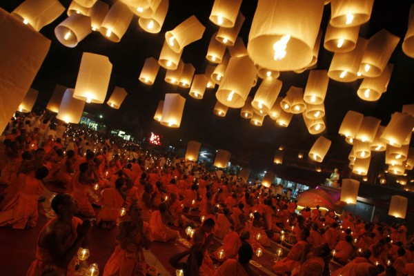 Buddhist monks release paper lanterns into the sky in Suphan Buri Province on Jan. 9, 2013. The lanterns were released during a traditional pilgrimage to pay homage to Lord Buddha and bless Thailand as it enters the new year.