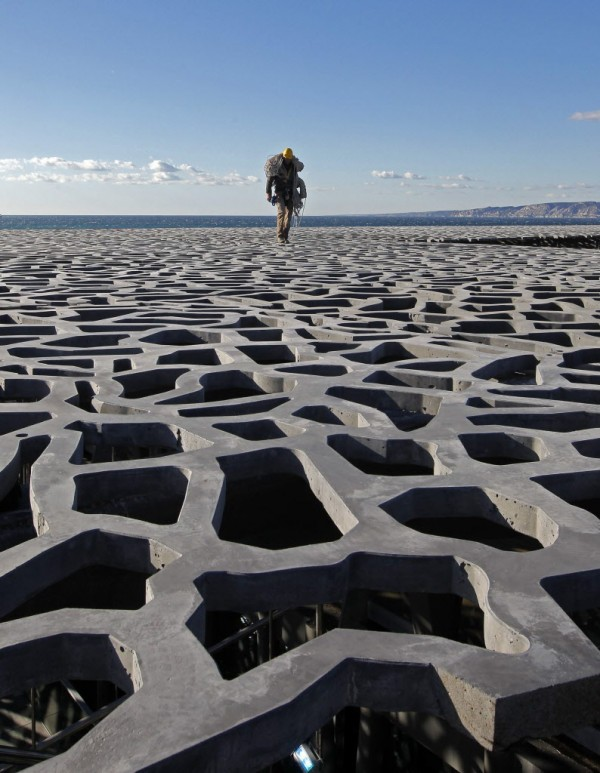 A worker walks on the roof of the Museum of Civilizations from Europe and the Mediterranean (MuCEM) in Marseille on Jan. 11, 2013. The museum, based in the Fort Saint-Jean overlooking the southern French city will open 2013 as Marseille will be the European Capital of Culture.