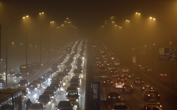 Vehicles drive on the Third Ring Road on a very hazy winter day in Beijing January 12, 2013. Microscopic pollutant particles in the air have killed some 8,600 people prematurely in 2012 and cost $1 billion in economic losses in four Chinese cities, according to a study by Beijing University and Greenpeace. The study of pollutant levels of PM2.5, or particles smaller than 2.5 micrometres in diameter, in Beijing, Shanghai, Guangzhou and Xi'an called for PM2.5 levels to be cut to World Health Organisation guidelines, which would reduce deaths by over 80 percent, the China Daily newspaper reported.