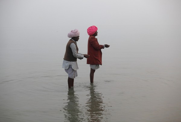 Hindu pilgrims pray after taking a holy dip at the confluence of the river Ganges and the Bay of Bengal at Sagar Island, south of Kolkata January 12, 2013. Hindu monks and pilgrims are making their annual trip to Sagar Island for the one-day festival of &quotMakar Sankranti&quot on January 14.