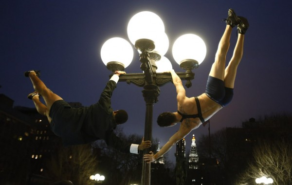 Men swing on a pole in Union Square park after the No Pants Subway Ride in New York on Jan. 13, 2013. The event is an annual flash mob and occurs in different cities around the world, according to its organizers.