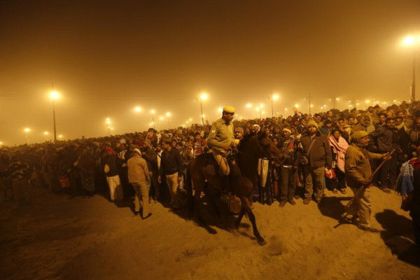 A policeman mounted on his horse maintains order during the first &quotShahi Snan&quot (grand bath) at the ongoing &quotKumbh Mela&quot, or Pitcher Festival, in the northern Indian city of Allahabad on Jan. 14, 2013. Upwards of a million elated Hindu holy men and pilgrims took a bracing plunge in India's sacred Ganges river to wash away lifetimes of sins on Monday, in a raucous start to an ever-growing religious gathering that is already the world's largest.