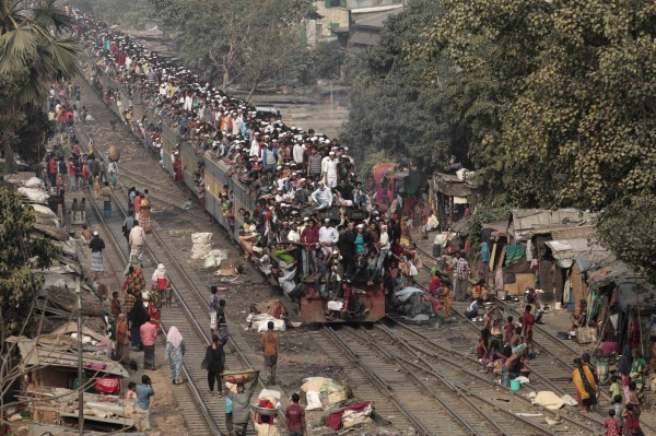 Commuters ride on the roof of a train as they come back to the city after attending the final prayer of Biswa Ijtema in Dhaka January 20, 2013. Thousands of Muslims joined the Akheri Munajat, the final supplication as the second phase of the Muslims congregation concluded by seeking forgiveness and blessings for mankind on Sunday, local media reported.