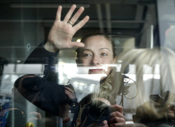 Florence Cassez waves through a bus window at her arrival at Charles de Gaulle Airport in Roissy, near Paris on Jan. 24, 2013. Mexico's top court on Wednesday freed Cassez, who was convicted of kidnapping, ruling that her trial was tainted and ending a seven-year imprisonment that strained ties with France. Cassez was sentenced to 60 years in prison after she was arrested in 2005 at a ranch near Mexico City with her former boyfriend, who led a kidnapping gang called the Zodiacs.