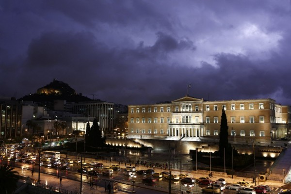A storm illuminates the sky over the Greek parliament in Athens on Jan. 24, 2013.