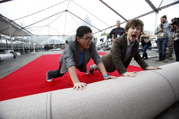 Actors Rico Rodriguez (left) and Nolan Gould from the television show &quotModern Family&quot symbolically roll out the red carpet during preparations for the 19th annual Screen Actors Guild Awards in Los Angeles, Calif., on Jan. 26, 2013.