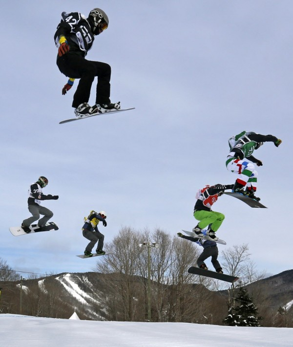 Sweden's Folger Forsen (black), Slovenia's Rok Rogelj (white), France's Tony Ramoin (yellow), Italty's Luca Matteotti (green), Canada's Kevin Hill (red) and France's Pierre Vaultier (blue) compete during the men's Snowboard-Cross eighth-finals at the FIS Snowboard World Championships in Stoneham, Quebec on Jan. 26, 2013.