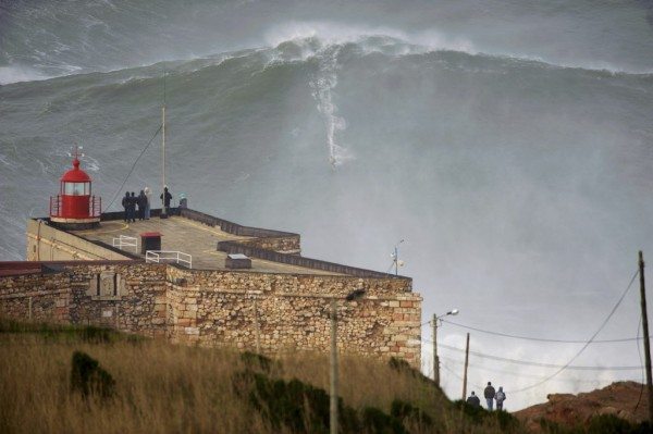 Big-wave surfer Garrett McNamara drops in on a large wave at Praia do Norte in Nazare in this handout photo provided by To Mane on Jan. 29, 2013. McNamara of Haleiwa, Hawaii, who won the Biggest Wave title at the 2012 Billabong XXL Big Wave Awards with his world record 78-foot wave ridden at Praia do Norte on Nov. 1, 2011. McNamara has returned to Nazare because he wants to try to beat the record again, and the forecast for the next days are of big waves.
