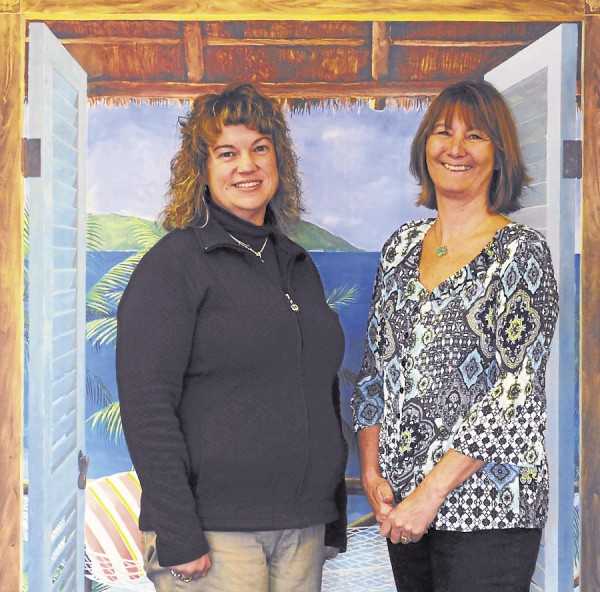 Donna Demmons (left) and Dee Anne McDonald, owners of All About Travel, specialize in smiles. The smiles that come from their services are due to helping travellers go to the destination of their dreams.