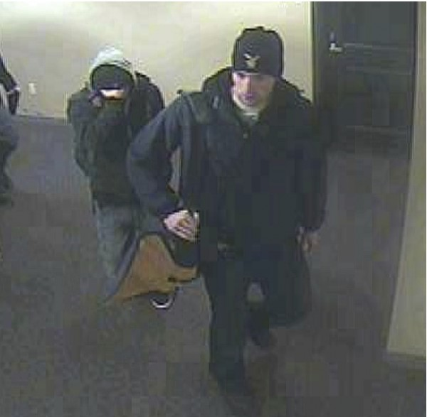 Two men suspected of robbing a Portland apartment at gunpoint.