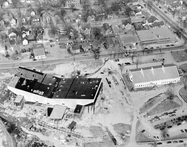 This aerial shot from April 1955 shows the auditorium well on its way to completion in time for its October dedication. The 1897 auditorium is at the right, with the Bangor Daily News building directly above it.
