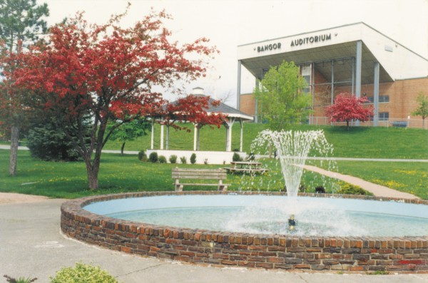 As the Bangor Auditorium stands atop its hill, a fountain sprays merrily in Bass Park in May 1995.
