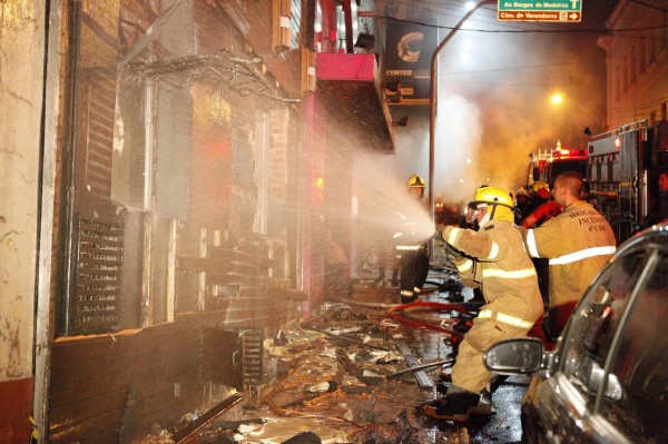 Fire-fighters try to extinguish a fire at Kiss nightclub in the southern city of Santa Maria, 187 miles west of the state capital of Porto Alegre, in this picture taken by Agencia RBS, January 27, 2013. At least 200 people were killed in the nightclub fire in southern Brazil on Sunday after a band's pyrotechnics show set the building ablaze, and fleeing patrons were unable to find the emergency exits, local officials said.