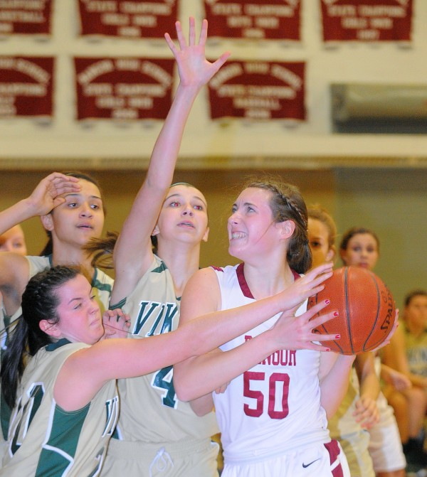 Bangor High School's Cordelia Stewart (right) drives for the basket as Oxford Hills High School players Abbie Eastman (lower left) Tianna Sugars (upper left) and Anna Winslow (center) try to block her during the game in Bangor Monday.