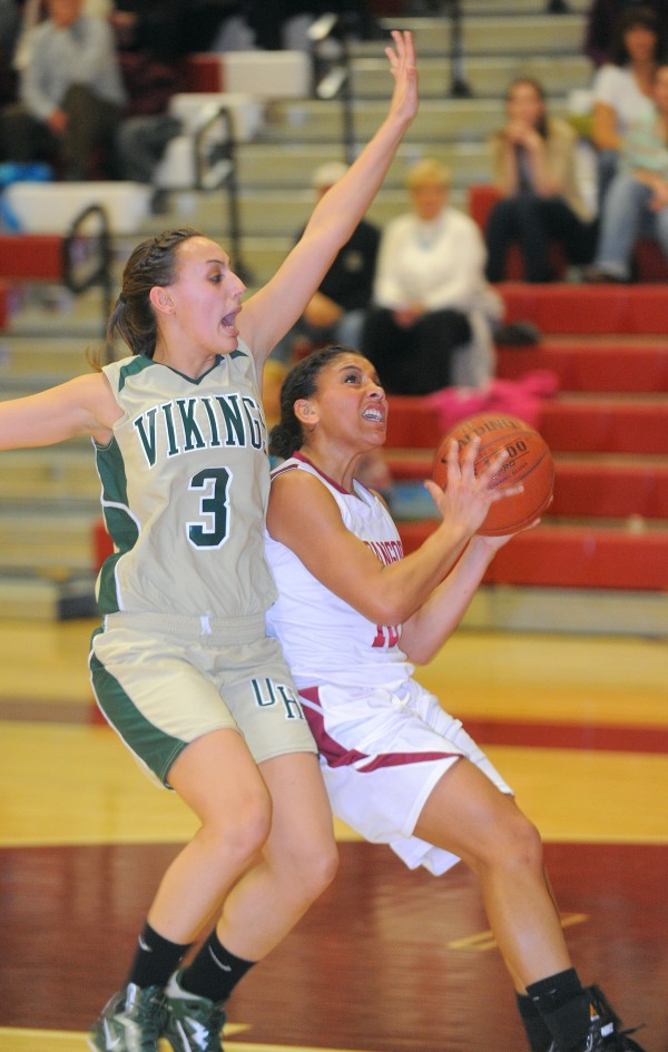 Bangor High School's Denae Johnson looks up for a shot as Oxford Hills High School's Crystal West tries to block her during the game in Bangor Monday.