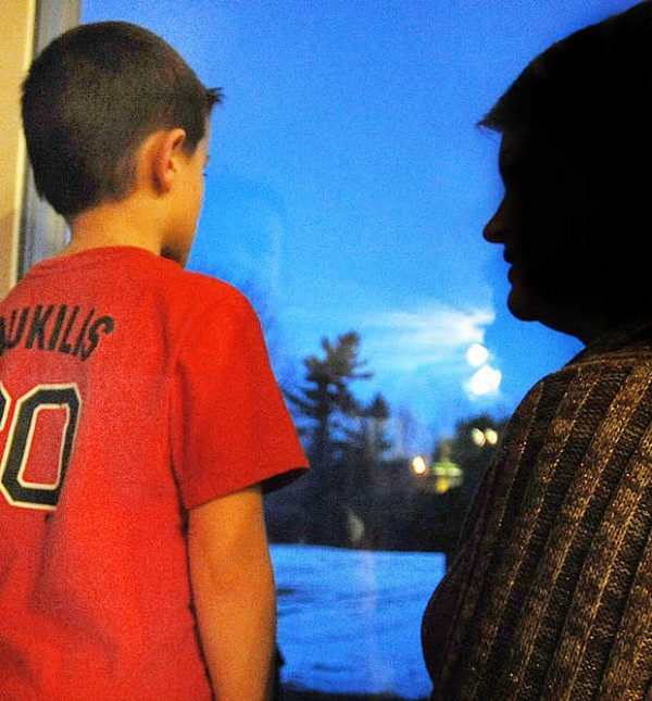 Jennifer looks out the window of her Oxford home with her 6-year-old son, Carter, who has been diagnosed with a host of problems, including autism, anxiety, depression, oppositional defiant disorder, a pervasive developmental delay and sensory processing issues.