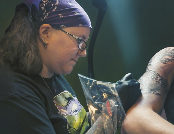 Artist Abby Lusk works on a design for a customer at Diversified Ink in Bangor in mid-January.