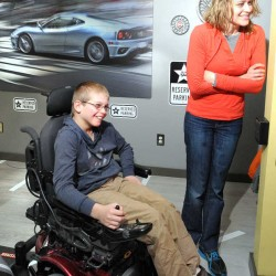 Josh Brochu, 10, of North Jay, has a rare genetic, degenerative medical condition called ataxia-telangiectasia. On Saturday, Make-A-Wish Maine revealed his room makeover in the design of a McDonald's drive-through. Josh and his mother, Lisa Brochu, watch as someone pretends to order food from the drive-through window.