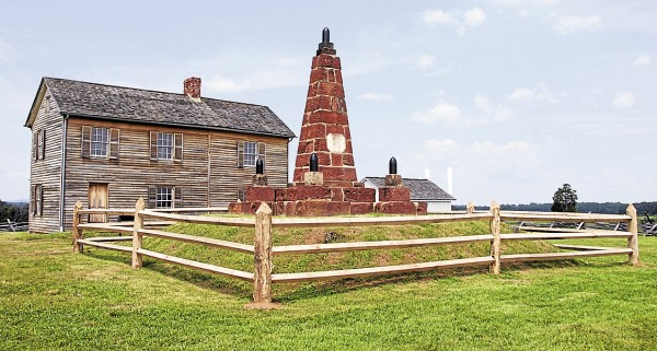 The first large Civil War monument to be erected on an actual battlefield was this monument built by Union troops on Henry House Hill at Manassas, Va. The monument was dedicated on June 10, 1865, exactly 51 weeks after the Soldiers' Monument was dedicated Bangor. Behind the Manassas monument stands the Henry House.