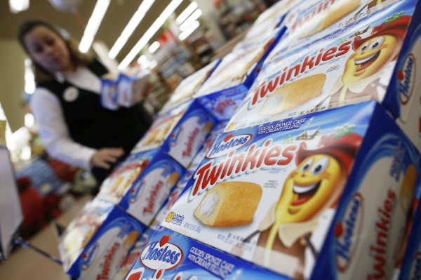 woman grabs some of the last boxes of Twinkies on display at a Jewel-Osco grocery store in Chicago on Dec. 11, 2012. Eleven companies have submitted bids to acquire the Hostess cake brands, which include Twinkies, out of the bankruptcy process, according to court documents filed this month.