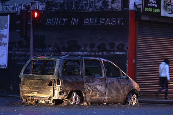 A burnt out car blocks Dee Street in east Belfast January 6, 2013. Pro-British militant groups are instigating and exploiting the riots that have rocked the Northern Irish capital Belfast in the past month, a police officers' representative said on Sunday. The violence, which stems from Loyalist protests over the removal of the British flag over Belfast City Hall, is among the worst in the province since a 1998 peace accord ended three decades of sectarian conflict.