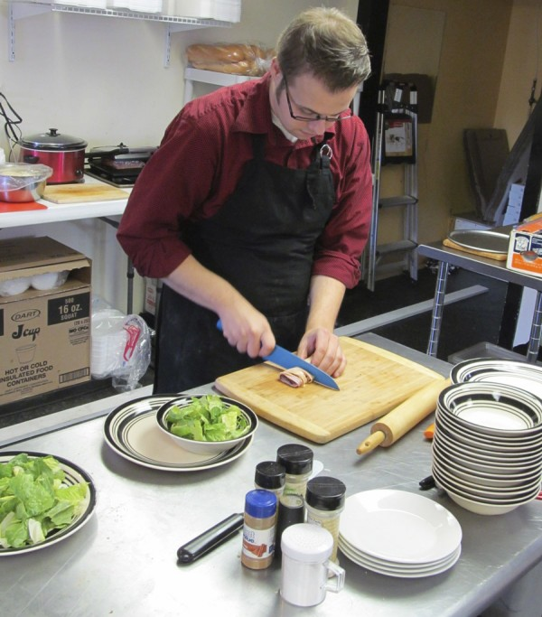 James Gallagher, the owner and chef of La Cena Italian Bistro & Pizzeria in Bangor, prepares a chef's salad in the restaurant's kitchen in mid-January. La Cena is located at 621 Hammond St., Bangor.