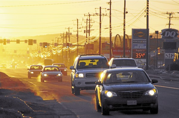 The rising sun casts light and shadow across the traffic on Wilson Street in Brewer at 7:10 a.m.