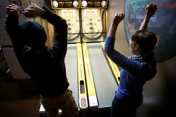 Caleb Collins (left) and Bridget Kahn compete in the First Annual Portland Skee-Ball Championship at Bayside Bowl Sunday afternoon Jan. 27, 2013.