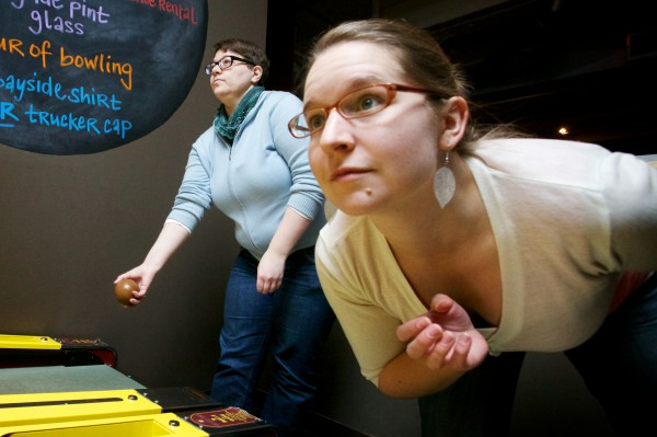 Anne Macri (left) and Sarah Bartlett compete in the First Annual Portland Skee-Ball Championship at Bayside Bowl Sunday afternoon Jan. 27, 2013.