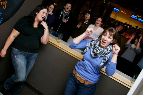 Bridget Kahn (right) celebrates her victory after beating Margaret Kennedy for the number one spot in the First Annual Portland Skee-Ball Championship at Bayside Bowl Sunday afternoon Jan. 27, 2013.