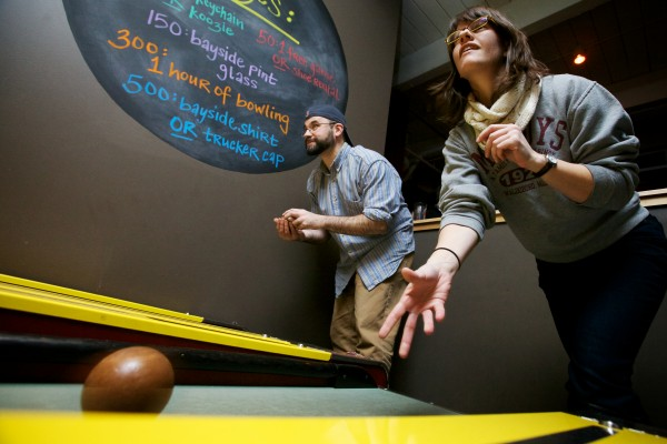Maris Toland (right) bowls in the First Annual Portland Skee-Ball Championship organized by Sam Heck (left) at Bayside Bowl Sunday afternoon Jan. 27, 2013. Skee-Ball was invented and patented by J.D. Estes of Philadelphia in 1909.