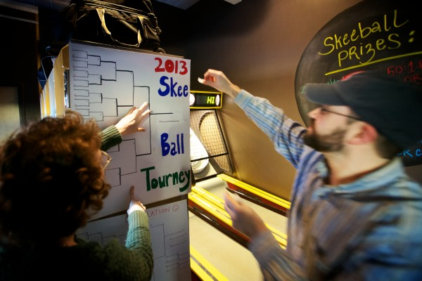Katie Worthing (left) and Sam Heck hang the brackets for the First Annual Portland Skee-Ball Championship at Bayside Bowl Sunday afternoon Jan. 27, 2013. The first national Skee-Ball tournament was held in Atlantic City in 1932.