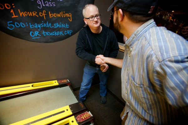 Brian McCambridge (left) and Sam Heck shake hands before competing against each other in the First Annual Portland Skee-Ball Championship at Bayside Bowl Sunday afternoon Jan. 27, 2013. The game was invented over a hundred years ago.