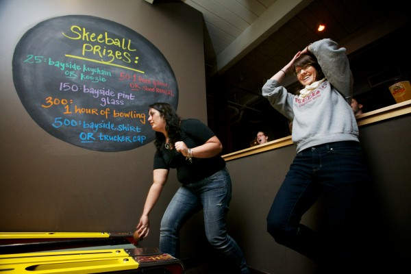 Maris Toland (right) reacts to a ball gone astray as Margaret Kennedy, who placed second overall, bowls in the First Annual Portland Skee-Ball Championship at Bayside Bowl Sunday afternoon Jan. 27, 2013.