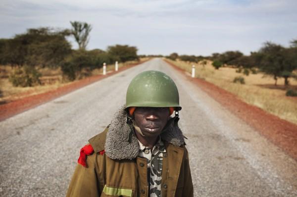 Malian soldier Ousmane Cisse stands guard on an open road outside Sevare, Mali, January 27, 2013.