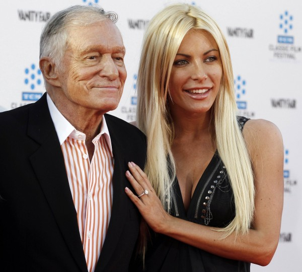 Hugh Hefner and his fiancee, Playboy Playmate Crystal Harris, arrive at the opening night gala of the 2011 TCM Classic Film Festival featuring a screening of a restoration of &quotAn American In Paris&quot in Hollywood, California in this file photo from April 28, 2011. Harris and Hefner tied the knot December 31, 2012, after an aborted June 2011 attempt.