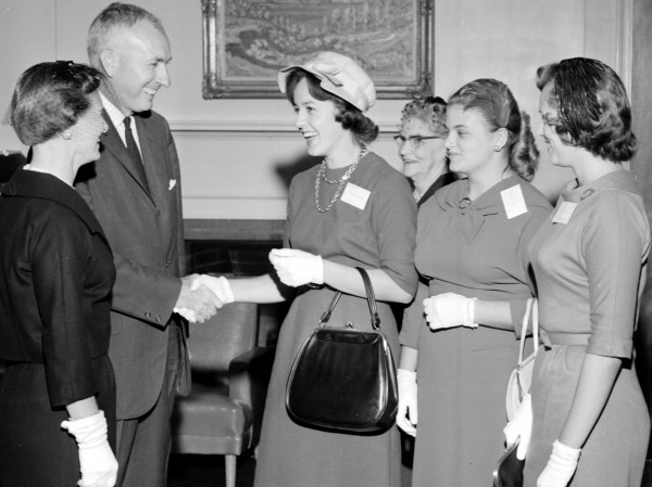 University of Maine President Lloyd H. Elliott greets Mary Twitchell (from left) of Fairfax, Va., and Rebecca Dow and Raeberta Jordan, both of Rockland, at the University of Maine's President's Reception for new students, Sunday, Sept. 18, 1960.