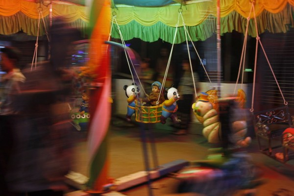 A child rides a merry-go-round at a pagoda festival in Yangon on Jan. 13, 2013.
