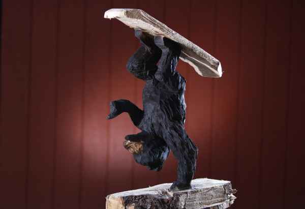 A 30-inch-tall carving depicts a bear performing a trick on a snowboard. &quotSomeone said he's got his feet on the board wrong, but I just said I guess bears ride snowboards different than we do,&quot said Josh Turner.