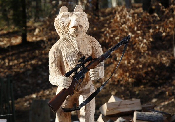 A 5-foot-tall bear was carved to hold anything from a rifle to a business sign — whatever the customer wants.