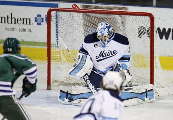 Maine goalie Martin Ouellette makes a save with his right pad in the second period against Mercyhurst at the Cumberland County Civic Center, Friday, Jan. 4, 2013, in Portland, Maine, 2012.